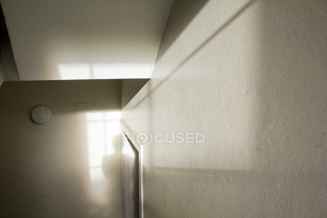 White apartment interior with light beam and human silhouette — Stock Photo