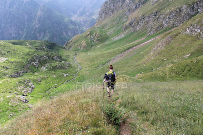 Traveler woman hiking in mountains at summer — Stock Photo