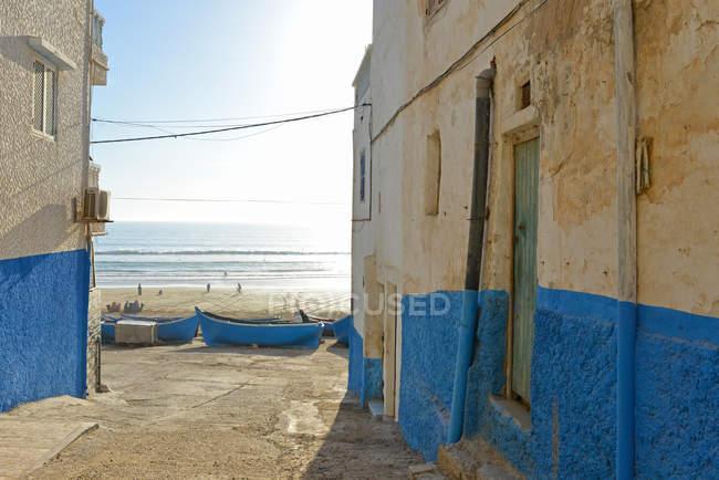 Exterior facades of building at beach with sea — blue, season