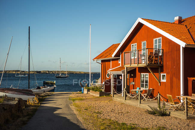 Typical scandinavian scene with wooden houses by the fishing village harbor at susnet — Stock Photo