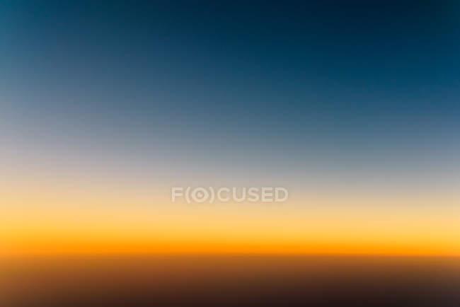 Sunset sky background, orange blue sky — Stock Photo