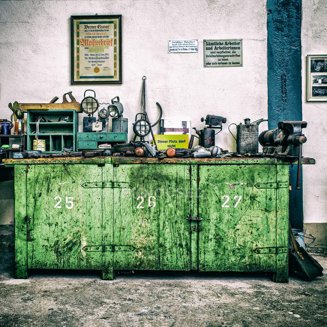 A cluttered work bench indoors — Stock Photo