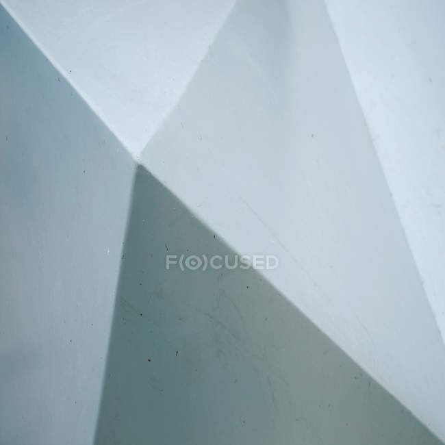High angle view of shadows falling on a white structured wall — Stock Photo