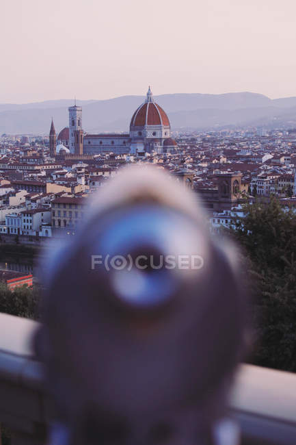 View in old part of city and blurred coin-operated binoculars — Stock Photo