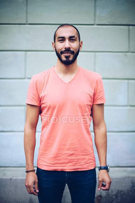 Handsome Hispanic smiling bearded man in casual clothing posing and looking at camera — Stock Photo