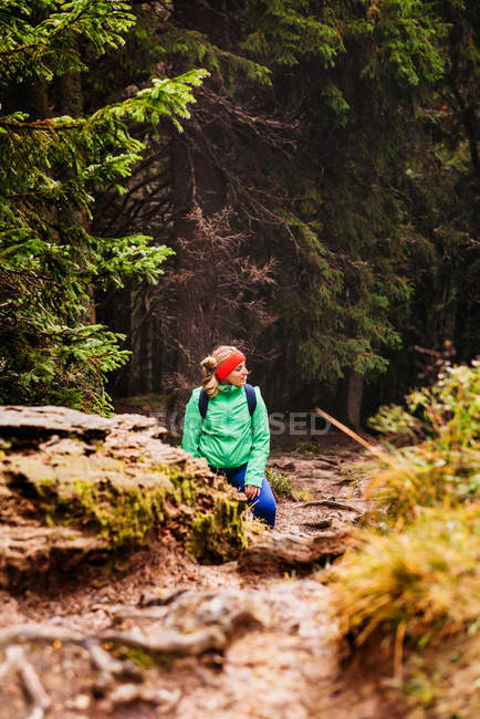 Caucasian woman hiker travelling in mountains — Stock Photo