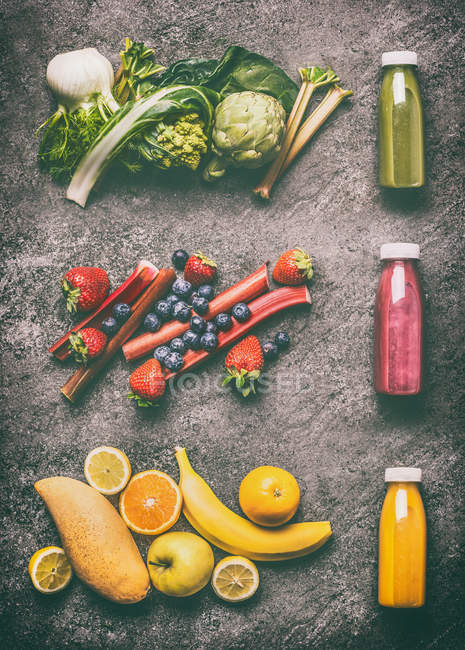 High angle view of fruit and vegetables on a grey background — Stock Photo
