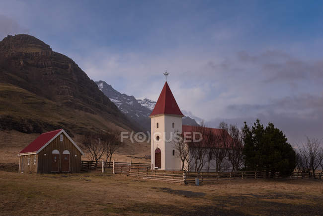 Church on field at mountains in Iceland — Stock Photo