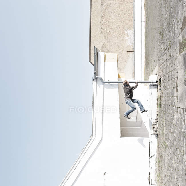 Side view of man balancing off a pole — Stock Photo