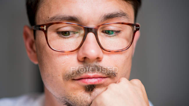 a6d087e2334 Close-up portrait of young man in eyeglasses — Stock Photo