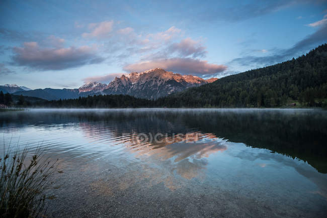 Panorama, mountains lake water with reflection of sunrise sky, alps — Stock Photo