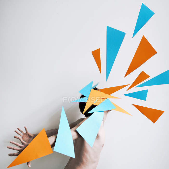 Studio shot of multi colored triangles against a white background — Stock Photo