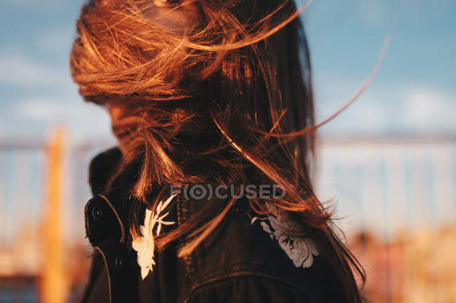 Side view of a woman with wind swept hair — Stock Photo