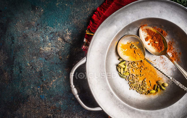 High angle view of colorful spices in a silver dish — Stock Photo