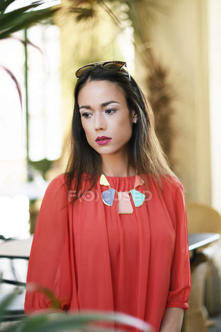 Elegant stylish asian woman in red dress and necklace — Stock Photo