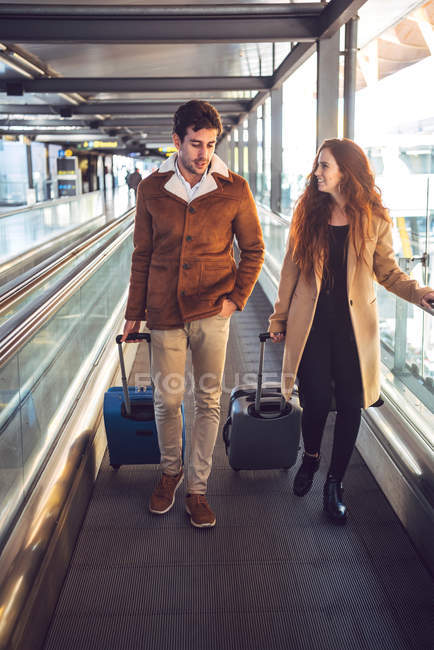 Lovely couple with suitcases in airport — Stock Photo