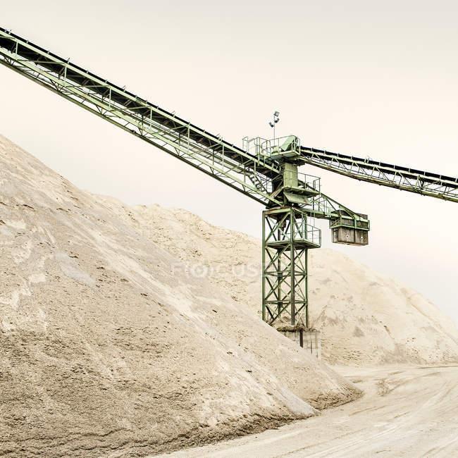 Crane against sky over sand hill — Stock Photo
