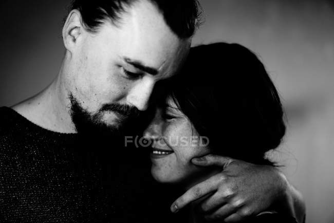 Close-up shot of a happy young couple embracing, monochrome — Stock Photo