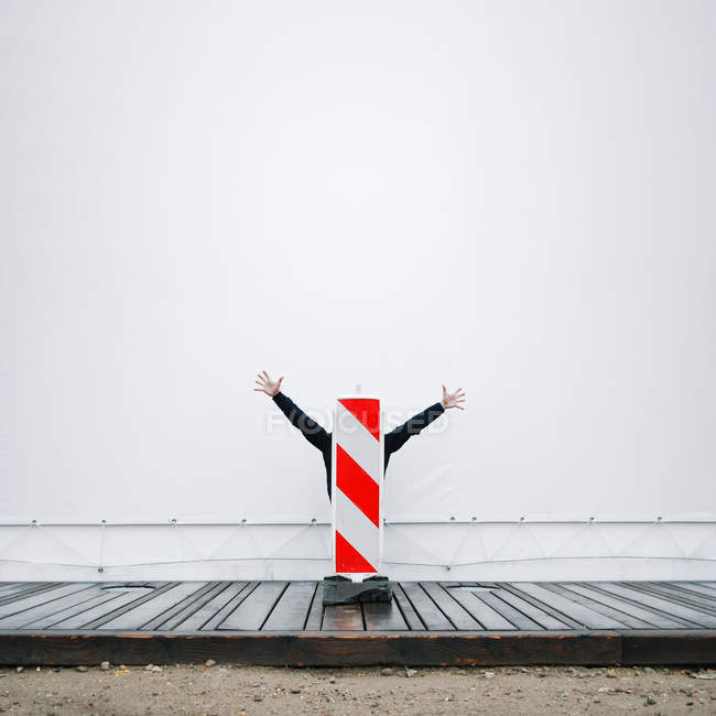 Human arms coming out of a bollard. — Stock Photo