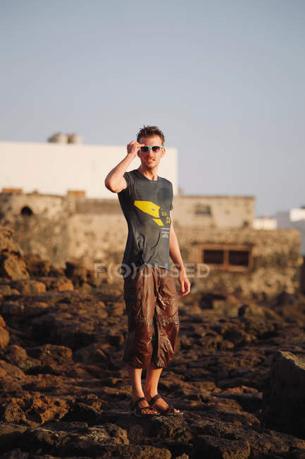 Full length portrait of a young man with wet pants — Stock Photo