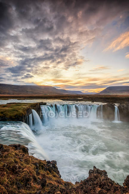 Scenic view of waterfall at sunset — Stock Photo