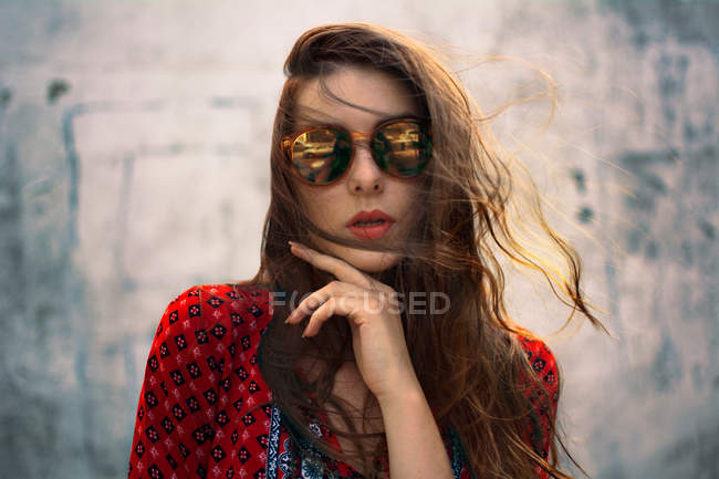 Close-up portrait of a young woman in sunglasses — Stock Photo