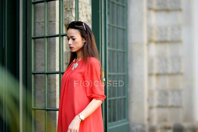 Elegant stylish asian woman in red dress — Stock Photo