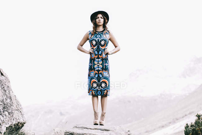 Full length fashion shot of woman posing in dress and hat — Stock Photo