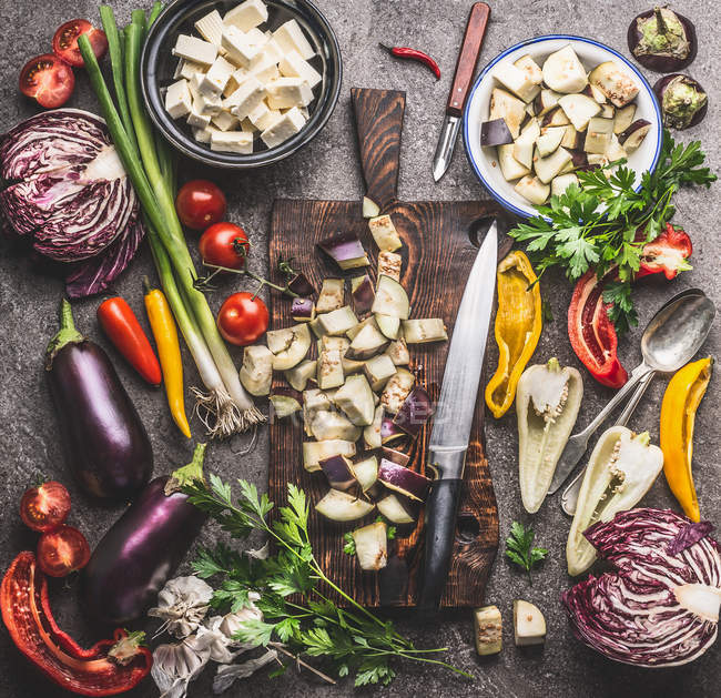 High angle view of fresh vegetables and food on a table — Stock Photo