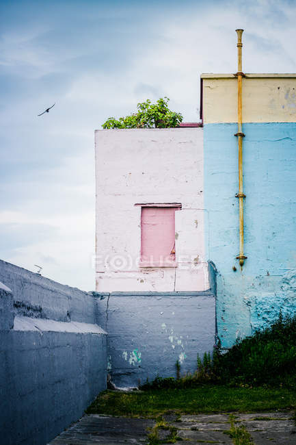 Colorful architectural buildings against a dull sky — Stock Photo