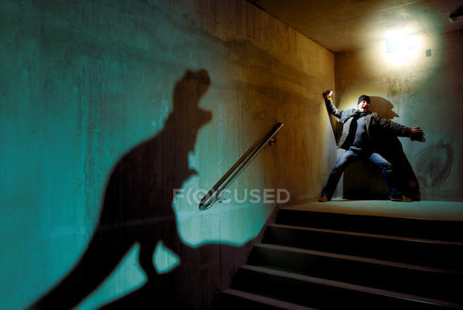 Man screaming on a staircase from a shadow — Stock Photo