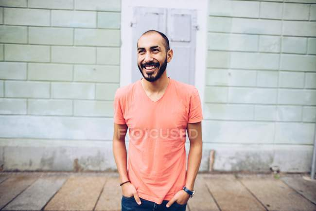 Handsome Hispanic smiling bearded man in casual clothing posing — Stock Photo