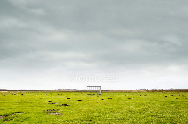Damaged football field with gates, football pitch — Stock Photo