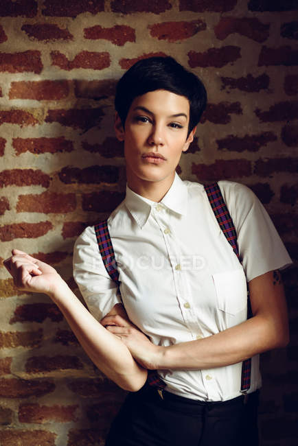 Woman with short hair wearing shirt with suspenders — Stock Photo