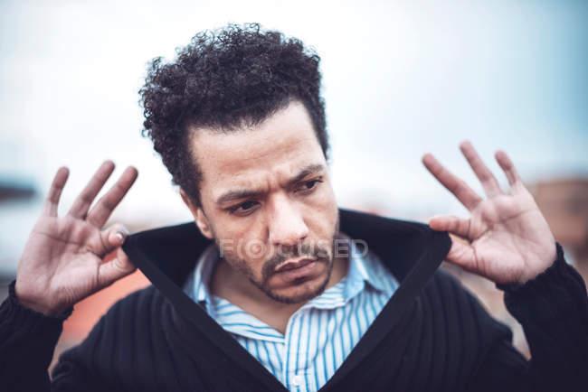 Confident attractive mulatto man in urban environment — Stock Photo