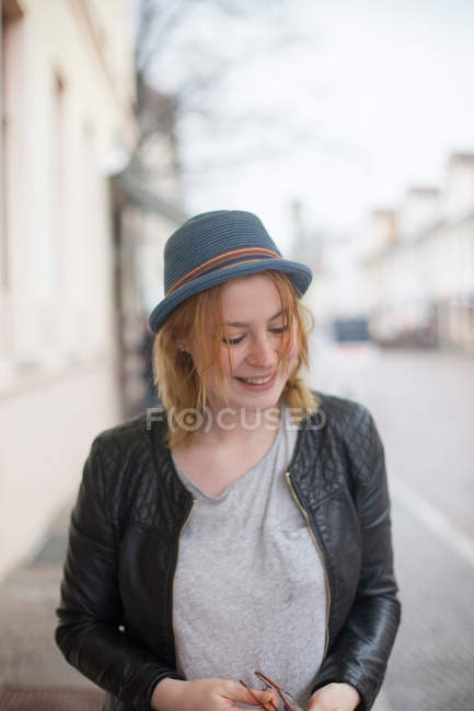 Fashion portrait of young blonde woman in a grey hat — Stock Photo