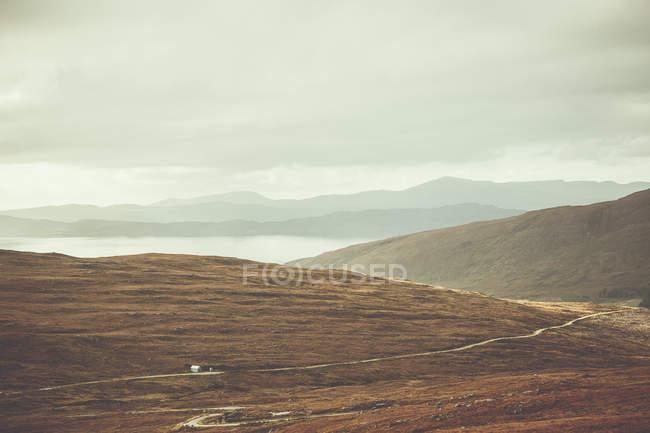 Mountainous landscape in autumn season with fog and mist — Stock Photo