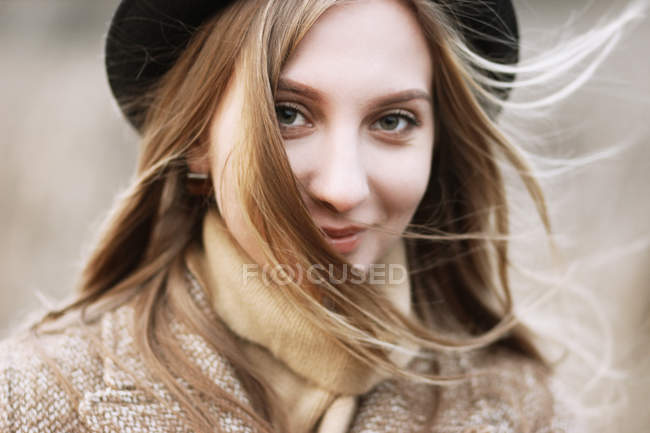 Portrait of beautiful woman wearing hat — Stock Photo