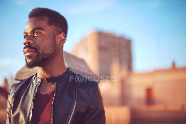 Black man in trendy clothes with standing outside — Stock Photo