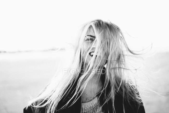 Attractive blonde woman with windswept hair — Stock Photo