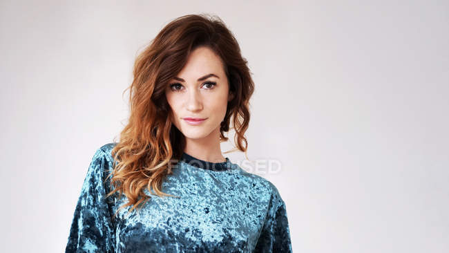 Portrait of beautiful woman with brown curly hair — Stock Photo