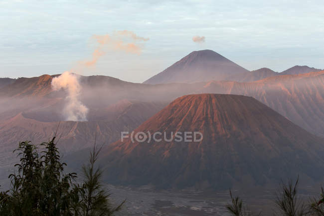 Volcanic craters with smoke, Indonesia Asia — Stock Photo