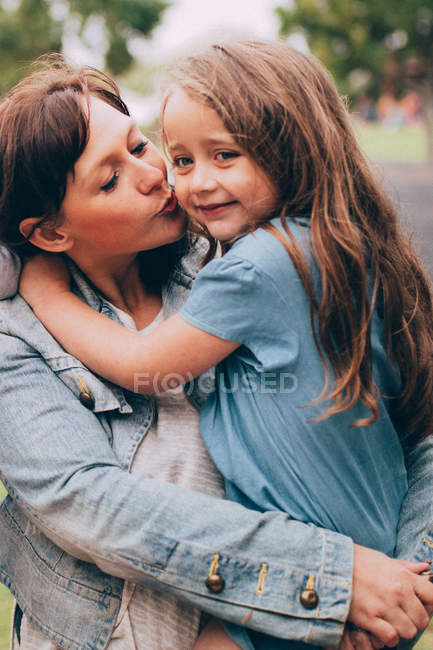 Portrait of happy mother, mother kissing daughter — Stock Photo