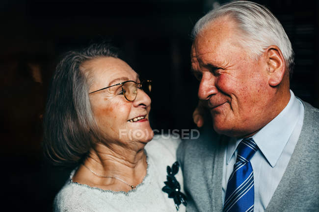 Elderly couple in love, pensioners embracing and looking at each other — Stock Photo