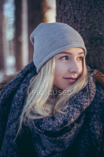 Portrait of young woman with blonde hair in winter — Stock Photo