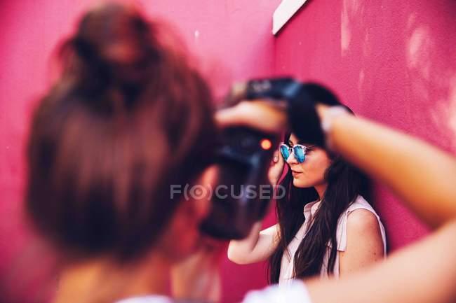 Photographer taking photo of woman — Stock Photo