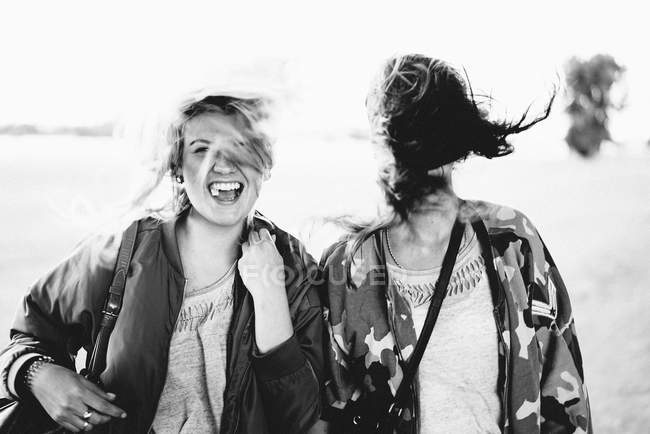 Laughing two best friends, women having fun outdoors — Stock Photo