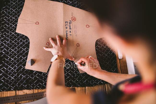 Elevated view of woman drawing template for fashion design — Stock Photo