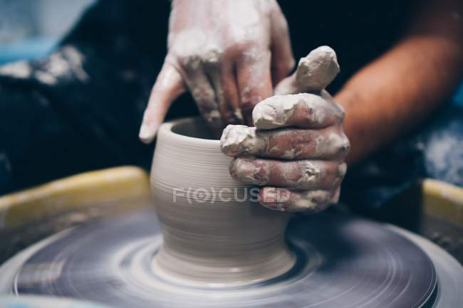 Human hands making pottery — Stock Photo