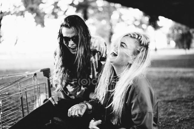 Laughing two best women  friends, black and white photo — Stock Photo